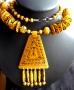 Tribal ketting (been) geel met decoratie